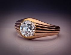 View this item and discover similar solitaire rings for sale at - A Faberge Diamond Solitaire Gold Ring circa 1900 A simple, yet elegantly designed, reeded gold ring is set with a sparking white old European cut diamond.