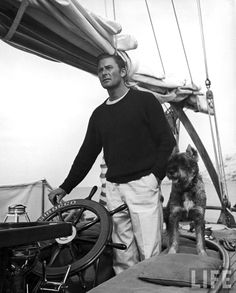 """life: """" On this day in Errol Flynn was born. Pictured, Peter Stackpole photographs Errol Flynn with his dog at the helm of a yacht while enjoying a fishing vacation. See more of Stackpole's work. Old Hollywood Stars, Hollywood Actor, Classic Hollywood, Vintage Hollywood, Hollywood Icons, Hollywood Glamour, Errol Flynn, Karen, Sail Away"""
