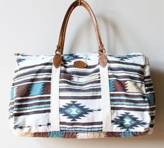 Cute Aztec looking duffle bag! This goes on my wish list.