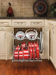 """This is the same link to the Rev-a-shelf two-tier pots, pans and lid organizer that I pinned before, but this is the wider model and it shows it w/ a double door cabinet (20-3/4"""", according to the page) -- and it has a bit of space left over for cookie sheets. from KitchenSource.com Pull Out Kitchen Cabinet, Modern Kitchen Cabinets, Kitchen Cabinet Organization, Kitchen Appliances, Kitchen Storage, Kitchen Pantry, Kitchen Reno, Kitchen Remodel, Cabinet Organizers"""
