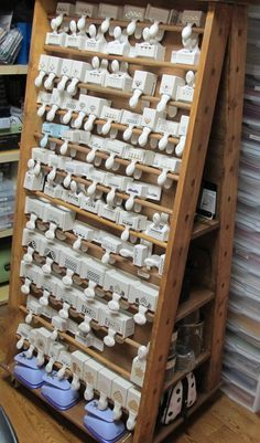 """This is a rolling cart DH made for me to store MORE punches. It is A shaped and has casters on it. Doweled """"shelves"""" on each side with cubbies on both ends to hold more stuff."""