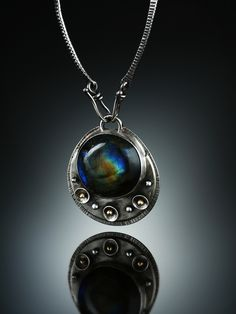 Labradorite Centerpiece. Fabricated Sterling Silver and 18k. www.amybuettner.com https://www.facebook.com/pages/Metalsmiths-Amy-Buettner-Tucker-Glasow/101876779907812?ref=hl https://www.etsy.com/people/amybuettner http://instagram.com/amybuettnertuckerglasow