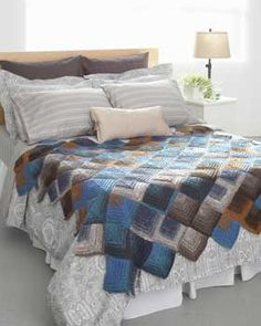 Mitered squares show off the long color changes in Bernat Mosaic and the exciting colors in this mitered square blanket can liven up any room.