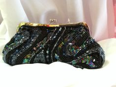 Beaded Clutch in Black: $34.99. Styles and colors not guaranteed. This item is currently at our Granite Bay Location. Call or Email for more information. Email: polkadotsproshop@gmail.com Phone: 916-791-9070