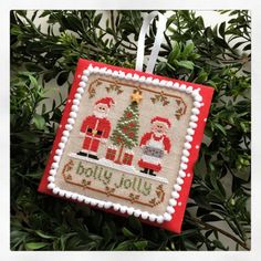 """Holly Jolly is the title of this cross stitch pattern that is the part of the series from Country Cottage Needleworks titled 'Classic Collections"""""""
