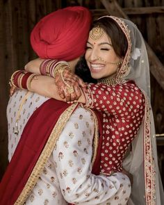 Punjabi Bride And Groom In A Coordinated Red And White Wedding Lehenga And Sherwani Bengali Wedding, Desi Wedding, Wedding Show, Saree Wedding, Wedding Couples, Wedding Day, Wedding Outfits, Wedding Groom, Indian Bridal