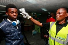 Health port officials uses a thermometer to screen passengers at the arrival hall of Murtala Mohammed International airport in Lagos, Nigeria Monday, Oct. 20, 2014. Water laced with salt and sugar, and gallons of the nasty tasting stuff. That's what doctors who survived Ebola in Nigeria are crediting for their survival. On Monday, the World Health Organization announced a rare victory in the months-long battle against the killer disease, declaring Nigeria is Ebola-free. (AP Photo/Sunday ...