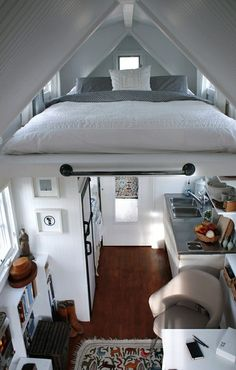 Saving space by sleeping tucked above the kitchen. Brilliant! :o/  I don't like high stuff!  A wall at the end would be nice!