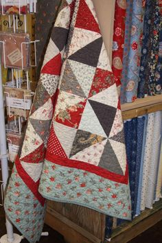 American Quilting.  The fabric is Moda Etchings - I love the simplicity of the Half Square Triangles.