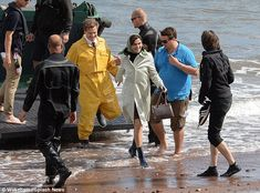 Helping hand: A grinning Rachel was assisted off the boat as Colin, who plays Crowhurst, f...