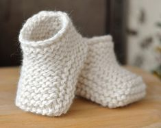 KNITTING PATTERN Baby Booties with Aran Cable Cuffs - This listing is for a PATTERN and not the finished item. Baby Booties in Classic traditional Aran Pattern - Double turn-down cuffs for comfort, luxury and security - difficult to kick off! The pattern is a fully illustrated tutorial with colour photos to show you each stage from start to finish. As such it is suitable for improving beginners keen to try out their cabling. The booties are knitted flat on regular, straight needles so you…