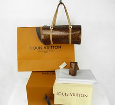 Sac à main Louis Vuitton Bedford Authentique d occasion en cuir vernis  couleur bronze + 356d3ba9602