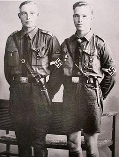 "Two senior Hitlerjugend members, probably late pre-war. Both are wearing the Hitler Youth Badge of Honour (probably the basic version, though the ""gold"" version cannot be excluded on the basis of the resolution of this 'photo). The boy to the right is wearing two badges for equestrian proficiency."