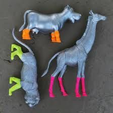 cute on shelves! painted plastic animals with neon