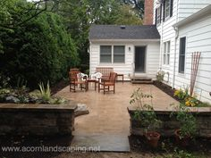 Outdoor Living Area with Pond-less Waterfall, Paver Patio, Sitting Wall, Pillars and Steps in Brighton NY by Acorn Landscaping of Rochester NY Landscaping With Fountains, Small Backyard Landscaping, Backyard Patio, Landscaping Ideas, Patio Ideas, Landscape Fountains, Backyard Waterfalls, Backyard Ideas, Diy Water Feature
