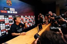 Head coach Gerardo 'Tata' Martino of FC Barcelona drinks water during a press conference at the Camp Nou Stadium on October 25, 2013 in Barcelona, Catalonia.