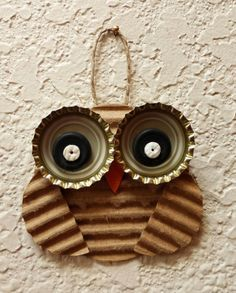 Bottle cap and corrugated cardboard owl. Nice up-cycling.