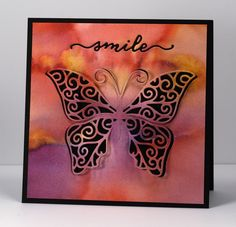 Smile black Heather Telford  Creative Die: Heartfelt, Swirling Wings(PB) Inks: Dusty Concord, Victorian Velvet, Ripe Persimmon, Spiced Marmalade distress stains (Ranger)  Cardstock: Fabriano 100% cotton hot pressed watercolour paper, Neenah Epic Black cardstock Also: Pearl-ex spray made with interference blue pearl-ex and water