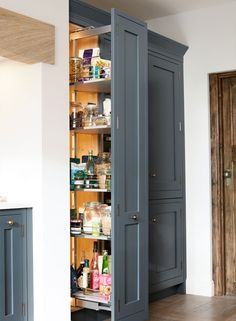 Crafted with meticulous attention to detail, 1909 is a beautiful Shaker-style painted kitchen with a timeless quintessentially British feel. Kitchen Pulls, Kitchen Units, Kitchen Ideas, Larder Unit, Larder Cupboard, Real Kitchen, Kitchen Paint, Blue Shaker Kitchen, Pocket Doors