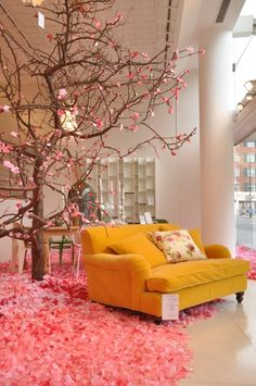 Store display at the Conran Shop in London. The flowering pink tree and carpet makes it feel like Spring inside. #retail #display #nature #tree #merchandising