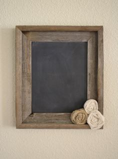 love the rosettes on this diy chalkboard-only I would keep the glass, use scrapbook paper and a dry erase marker!