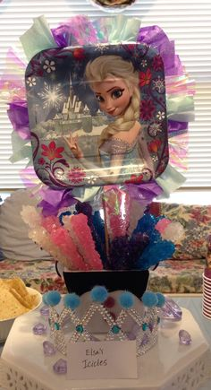 Frozen party ideas: plate centerpiece with tissue paper, glued on dowel rid with rock candy suckers (icicles) in a bucket. Easy, cheap, & cute
