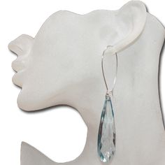 """Tear drop earrings, tear drop gem earrings.  These beautiful earrings are on a kidney wire hoop. The teardrop gem is surprisingly lightweight and tinted with color. The gem is approximately 2 1/2"""" inches long. They come in Peach, Clear, Blue, Pink or Purple. They are all the rage. Gorgeous earrings at such a great wholesale price of only $1.00 each pair."""