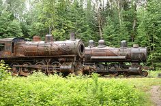 The locomotives were parked in their shed and shut down forever. The shed burned down in 1969, but the locomotives are still there