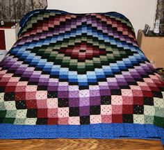 I think this is so cool to look just like a quilt, but I can imagine you'd be crocheting  little squares for years to have enough.