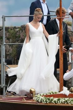 The 2015 royal wedding of Monaco: Beatrice Borromeo weds Pierre Casiraghi : Beatrice Borromeo wore a custom-made silk tulle dress from Armani Privé for the reception. Two family heirloom antique diamond wing brooches were pinned on the train.  For the earlier ceremony held at Isolino di San Giovanni (an island owned by the Borromeo famiy), she wore a lace Armani Privé dress.