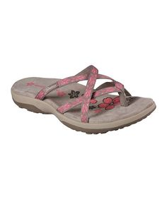 Crisscross straps frame the look of this sun-ready pair designed with a soft Memory Foam™ cushioned comfort footbed.1'' heelMemory Foam™ full-length cushioned comfort footbedSupportive, shock-absorbing midsoleWeb-textile upperSoft textile liningFlexible traction rubber soleImported