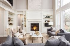 Beautiful living room interior with hardwood floors and fireplace in new luxury home. Large bank of windows hints at exterior view , Limestone Fireplace, Beautiful Living Rooms, Beautiful Family, Beautiful Space, Fireplace Design, Fireplace Ideas, Modern Fireplace, Fireplace Mantels, Fireplace Brick