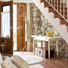 Under Stairs Decorating Ideas  rustic wood railing http://awoodrailing.com