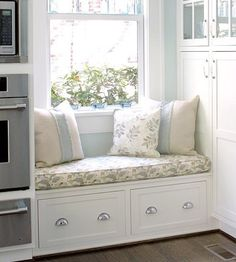 Kitchen window seat with storage below. by andrea@jardin