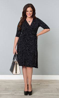 In a more subtle charcoal dot print, our Essential Wrap Dress was designed to be a key player in anyone's wardrobe.  A classic silhouette and timeless design makes this dress never go out of style.  Wear it to work or cocktails.