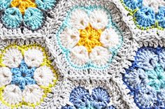 Color Inspiration ::  African Flower hexagon (original pattern by Heidi Bears) with white petals outlined in a single row of color.  Pretty overall color scheme.  #crochet #motif