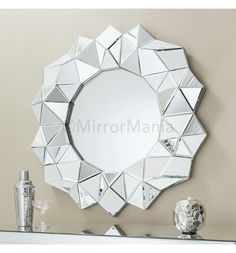 We love this Bevelled Round Wall Mirror which makes an impact on a light wall -   #HomeStyle