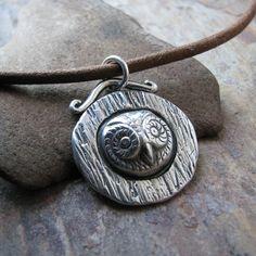 Cute owl in a tree pendant.