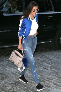Hadid loves the mix of a great pair of jeans and a statement piece—embracing the souvenir jacket as the look of the moment.