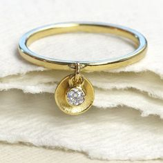 Stylish Engagement Rings That Don't Rely On Gemstones   Easy to stack, this alternative engagement ring slightly strays from the traditional ring settings. The charm highlights a small gemstone held within a bezel setting.