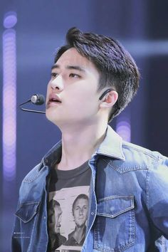 LOL why is D.O wearing a t-shirt with a Steve McQueen's mugshot?