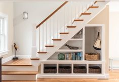Open shelves under stairs