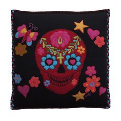 The fantastic Fiesta Scull cushion is hand embroidered with a Mexican 'Day of the Dead' scull and embellished with multicoloured hearts, stars and flowers.  The edges of the cushion are blanket stitched in red with the two vertical edges finished with red, yellow and black plaits ending with tassels on the corners.