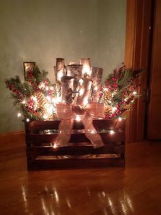 Stained box, birch logs, burlap ribbon, greens and lights Christmas Planters, Christmas Porch, Outdoor Christmas Decorations, Country Christmas, Winter Christmas, Christmas Holidays, Holiday Decor, Christmas Projects, Christmas Crafts
