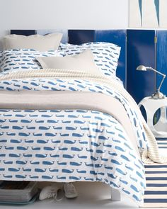 Nautical bedroom inspiration featuring our Mini Print Percale Whale Sheets.