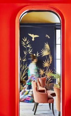 Baldwin | Gray Walker Interiors The view from my client's home bar/butlers pantry into her bold dining room. #interiordesign #homedecor #diningroom #boldcolor #navy #coral #homebar #bar