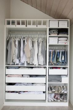 A perfect, clean, white wardrobe in which clothes and shoe are perfectly stored and organised by colour and item type.