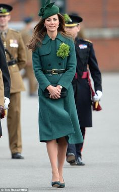 The Duchess was wearing a £169 coat by High Street store Hobbs, a Gina Foster hat and an Irish Guards brooch with a shamrock as she met with guards.
