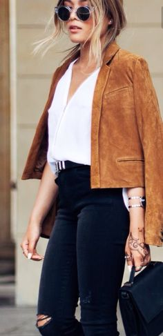 Orange suede pants with white crop top and perhaps black jacket. With black tie up choker piece