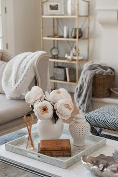 Looking for ways to elevate your fall home decor? Try a few stems of these ivory fake peonies in a ginger jar! They're the perfect addition to your fall home decor or fall wedding flowers. Shop artificial fall peony stems at Afloral.com. Image by @homewithhollyj.